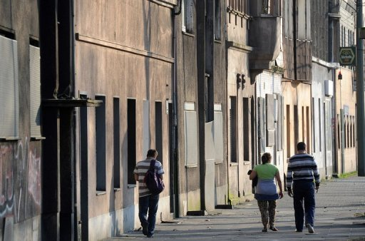 &lt;p&gt;Inhabitants walk by empty houses in the western German city of Duisburg Bruckhausen in the Ruhr region in March 2012. The economic &quot;miracle&quot; that has enabled Germany to escape the worst of Europe&#39;s debt crisis is largely passing by some of the most vulnerable people in society, critics say.&lt;/p&gt;