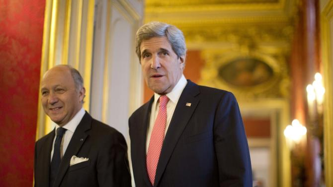 U.S. Secretary of State John Kerry, right, walks to a meeting with France's Foreign Minister Laurent Fabius at the Quai d' Orsay in Paris, March 27, 2013.  (AP Photo/Jason Reed, Pool)