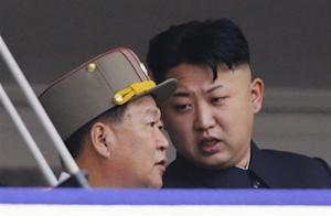 North Korean leader Kim speaks to Choe, director of the General Political Bureau of the KPA, during a parade in Pyongyang