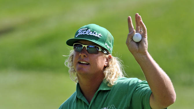 Charley Hoffman waves to the crowd after a birdie on the 18th hole during the first round of the Travelers Championship golf tournament in Cromwell, Conn., Thursday, June 20, 2013. (AP Photo/Fred Beckham)