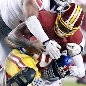 Washington Redskins quarterback Robert Griffin III and Redskins eliminated from playoffs