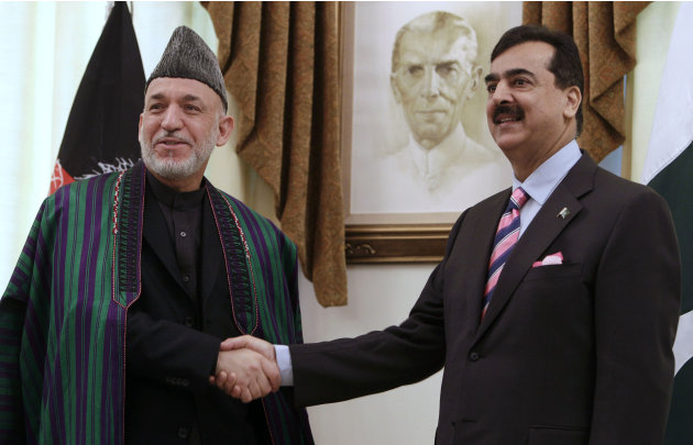 Afghan President Hamid Karzai, left, shakes hands with Pakistan's Prime Minister Yousaf Raza Gilani at Prime Minister House in Islamabad, Pakistan on Thursday, Feb. 16, 2012. Karzai arrived in Pakistan for talks on how Islamabad can facilitate peace negotiations with the Afghan Taliban.