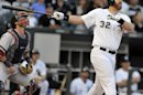 Chicago White Sox's Adam Dunn watches his three-run home run during the first inning of a baseball game against the Boston Red Sox in Chicago, Monday, May 20, 2013.(AP Photo/Paul Beaty)