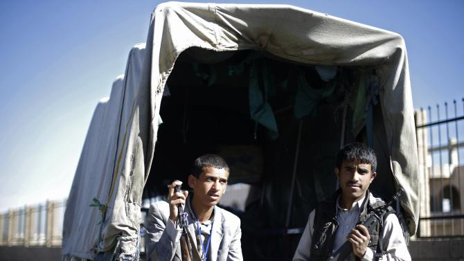 Houthi fighters secure the vicinity of a Houthi gathering in Sanaa