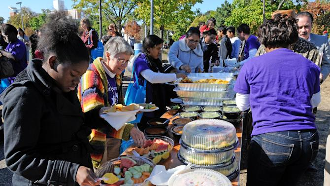 Food was served up during the agency's Celebration 'de Amistad after a MetLife Foundation presentation  of a $500,000 grant  to support Big Brothers Big Sisters' national Hispanic mentoring program in Stewart Park, Sunday, Sept. 23, 2012 in Minneapolis. The award brings MetLife Foundation's support for Big Brothers Big Sisters' National Hispanic Mentoring Program to $2 million since 2008. (Craig Lassig /AP Images for Big Brothers Big Sisters of America)