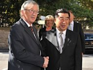 "Luxembourg Prime Minister and Eurogroup president Jean-Claude Juncker (L) welcomes China Vice Prime minister Hui Liangyu prior to a lunch working session at the ""Bouquet Garni"" restaurant in Luxembourg"