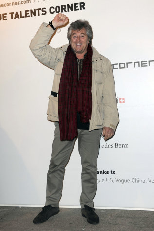 In this photo taken on Feb. 23, 2010, Vittorio Missoni poses for photographers in Milan, Italy. The search resumed Saturday, Jan. 5, 2013 for a small plane that has disappeared off the Venezuelan coast with six people aboard, including Vittorio Missoni, a top executive in Italy&#39;s Missoni fashion house, officials said. Vittorio Missoni, 58, is the director general of the iconic brand and the eldest son of the company&#39;s founder. Flying with him on Friday&#39;s flight from Venezuela&#39;s Los Roques resort archipelago to Caracas, was Missoni&#39;s wife, Maurizia Castiglioni, two Italian friends of the couple, and a crew of two Venezuelans. (AP Photo/Gian Mattia d&#39;Alberto, Lapresse)
