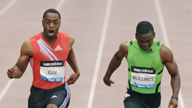 Jamaica's Steve Mullings, right, won the 100-meter race over Tyson Gay of the U.S., despite both finishing with an identical time of 10.26 seconds at the Adidas Grand Prix on Randall's Island in New York, Saturday, June 11, 2011. (AP Photo/Henny Ray Abrams)