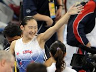 North Korea&#39;s Un Jong-Hong waves to spectators after winning the gold in the women&#39;s vault final of the artistic gymnastics event of the Beijing 2008 Olympic Games. In Beijing, N.Korea won two gold, one silver and three bronze medals to finish in 34th place overall