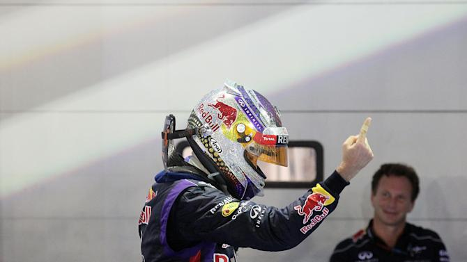 Red Bull driver Sebastian Vettel, left, of Germany celebrates while his team principal Christian Horner, right, looks on, after winning the Singapore Formula One Grand Prix on the Marina Bay City Circuit in Singapore, Sunday, Sept. 22, 2013