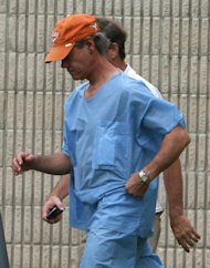 Randy Travis, front, exits the Grayson County jail Wednesday Aug. 8, 2012, in Sherman, Texas, after being arraigned on charges of driving while intoxicated and retaliation. (AP Photo/The Herald Democrat, Chris Jennings) (AP Photo/The Herald Democrat, Chris Jennings) TV OUT; MAGS OUT; TV AND MAGAZINE CALL FOR RATES TERMS;MANDATORY CREDIT