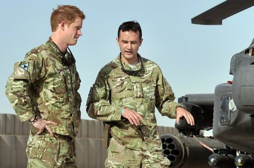 <p>Prince Harry (L) is shown the Apache flight-line by a member of his squadron at Camp Bastion in Afghanistan's Helmand province on September 7. The Taliban said Monday it was determined to kill Harry, who is currently serving in Afghanistan.</p>