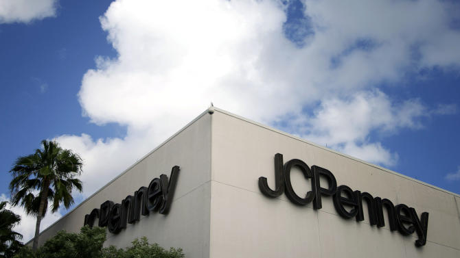 This Monday, Aug. 19, 2013 photo shows a J.C. Penney store in a Pembroke Pines, Fla., shopping center. Shares of J.C. Penney Co. got a boost Tuesday, Oct. 8, 2013, after the struggling department store chain said a key sales barometer improved in September from August and it expects that it will have ample liquidity at year end. (AP Photo/J Pat Carter)