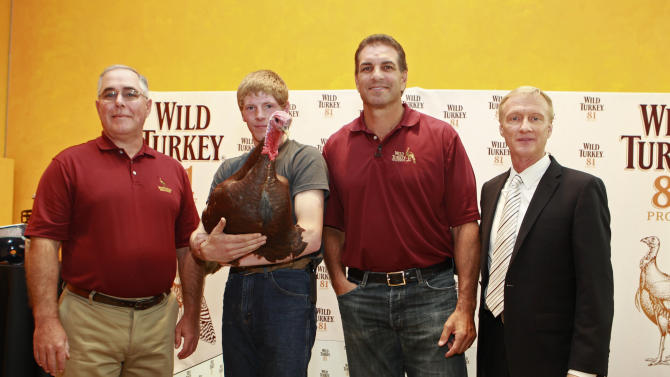 IMAGE DISTRIBUTED FOR WILD TURKEY - Wild Turkey's associate master distiller Eddie Russell , Turkey handler Robert Rastly, football picking turkey Jimmy Junior, football legend Vinny Testaverde, and sports announcer Jimmy Lennon Jr at the Wild Turkey Triple Barrel Challenge, on Tuesday, Nov. 20, 2012 in New York. (Photo by Mark Von Holden/Invision for Wild Turkey/AP Images)