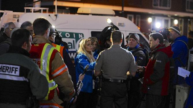 CORRECTS MALL LOCATION - Media gather around Clackamas County sheriff's Lt. James Rhodes during a news conference at the scene of a multiple shooting at Clackamas Town Center Mall in Portland, Ore., Tuesday Dec. 11, 2012. A gunman is dead after opening fire in the Portland, Ore., area shopping mall Tuesday, killing two people and wounding another, sheriff's deputies said. (AP Photo/Greg Wahl-Stephens)