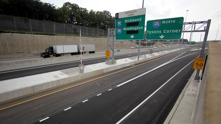 In this photo taken Wednesday, May 16, 2012, newly constructed roadways are seen in Fairfax County, Va. Driving onto an Interstate highway? Crossing a bridge on the way into work? Taking a tunnel under a river or bay? Get ready to pay. With Congress unwilling to contemplate an increase in the federal gas tax, motorists are likely to be paying ever more tolls as the government searches for ways to repair and expand the nation's congested highways.  (AP Photo/Haraz N. Ghanbari)