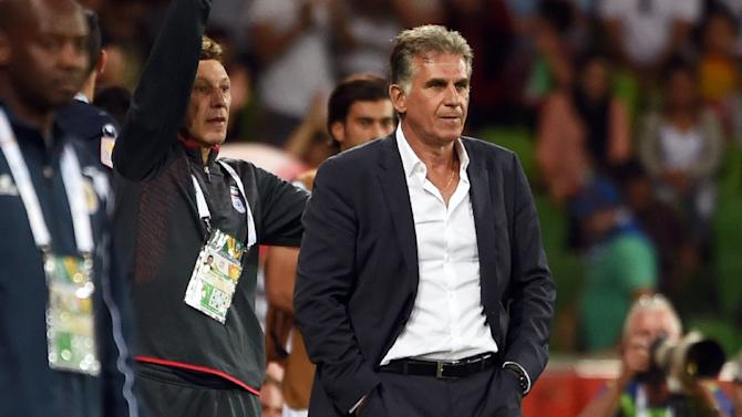 Iran's coach Carlos Queiroz (C), seen during their AFC Asian Cup match against Bahrain, in Melbourne, on January 11, 2015