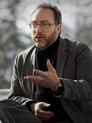 Jimmy Wales, founder of Wikipedia gestures during an interview with the Associated Press at the World Economic Forum, WEF, in Davos, Thursday, Jan. 26, 2012. Wales is fighting to stop a recent US plan to tighten anti-piracy laws and his vision for the open-source online encyclopedia. (AP Photo/Anja Niedringhaus)