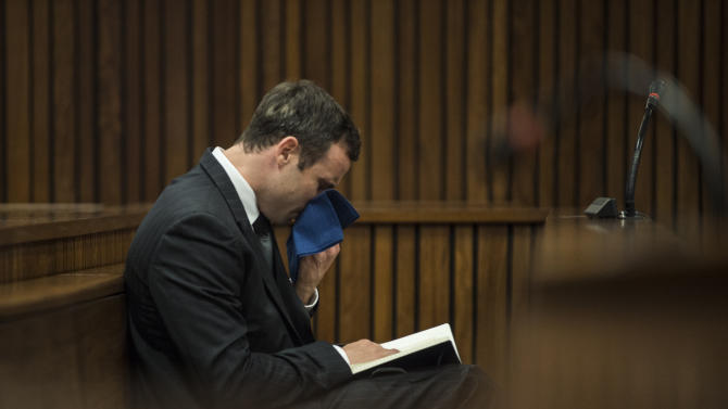 Oscar Pistorius reacts as he listens to the state prosecutor summarizing evidence at his murder trial in Pretoria, South Africa, Thursday, Aug. 7, 2014. The chief prosecutor said Thursday the double-amputee athlete's lawyers have floated more than one theory in a dishonest attempt to defend against a murder charge for his killing of girlfriend Reeva Steenkamp. (AP Photo/Mujahid Safodien, Pool)