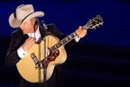 FILE - A June 16, 2011 file photo shows country singer Dwight Yoakam performing at the 42nd Annual Songwriters Hall of Fame Awards in New York. Yoakam&#39;s first album in his return to Warner Bros. Records comes out Sept. 18, 2012. (AP Photo/Charles Sykes, file)