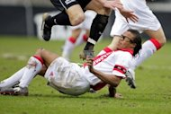 Edgar Davids tumbles after a clash with Bas Sibum (top) while playing for Ajax against Nec in Nijmegen in 2008
