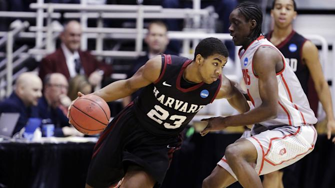 Harvard's Wesley Saunders (23) drives around New Mexico's Tony Snell (21) in the first half during a second-round game in the NCAA college basketball tournament in Salt Lake City, Thursday, March 21, 2013. (AP Photo/Rick Bowmer)