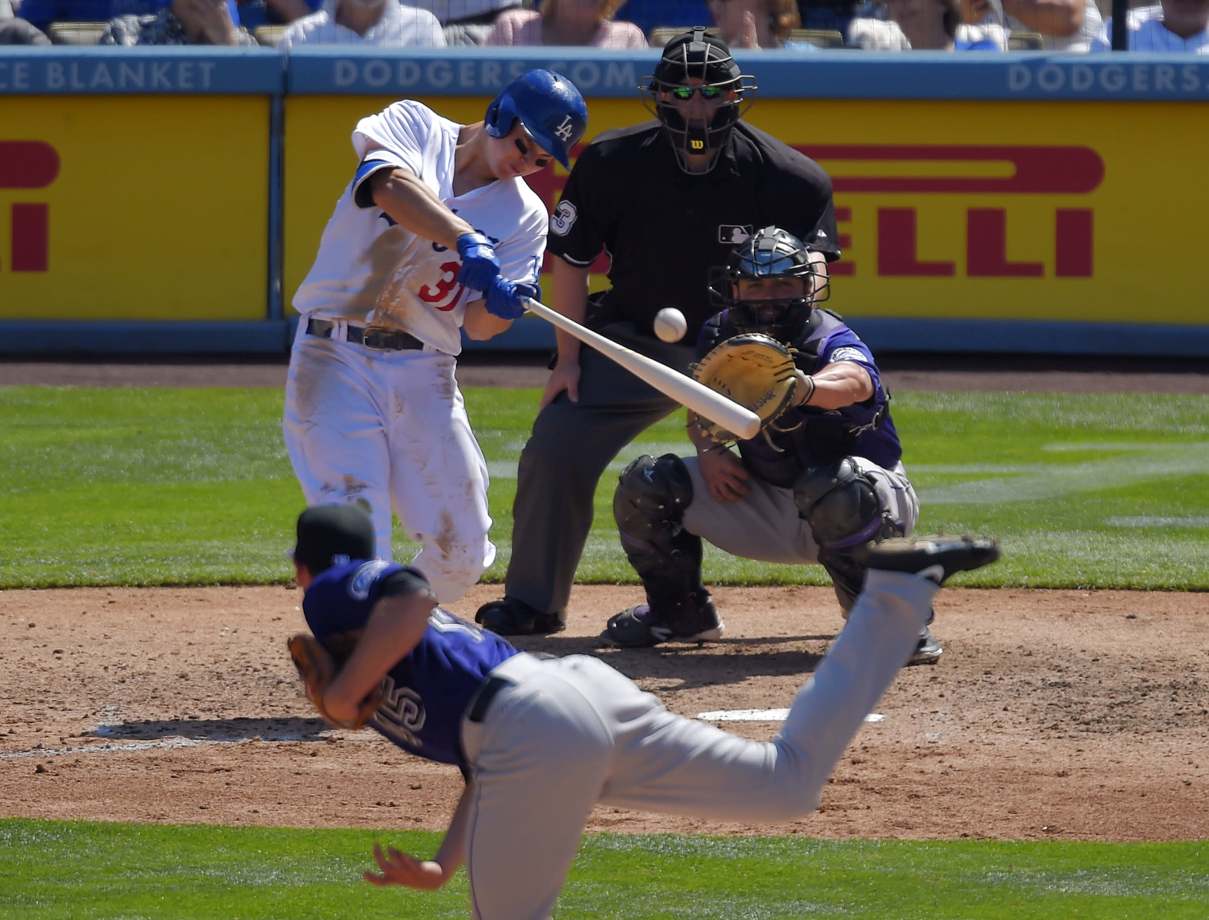Dodgers hit 3 HRs in 6th to rout Rockies 7-0