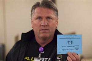 A union member displays his vote against the proposed contract during a union vote at the International Association of Machinists District 751 Headquarters in Seattle