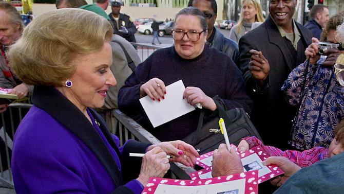 """FILE - In this Feb. 14, 2001 file photo, """"Dear Abby"""" advice columnist Pauline Friedman Phillips, 82, known to millions of readers as Abigail van Buren, signs autographs for some of dozens of fans after the dedication of a """"Dear Abby"""" star on the Hollywood Walk of Fame in Los Angeles.  Phillips, who had Alzheimer's disease, died Wednesday, Jan. 16, 2013, she was 94.  Phillips' column competed for decades with the advice column of Ann Landers, written by her twin sister, Esther Friedman Lederer. Their relationship was stormy in their early adult years, but later they regained the close relationship they had growing up in Sioux City, Iowa. The two columns differed in style. Ann Landers responded to questioners with homey, detailed advice. Abby's replies were often flippant one-liners. (AP Photo/Reed Saxon)"""