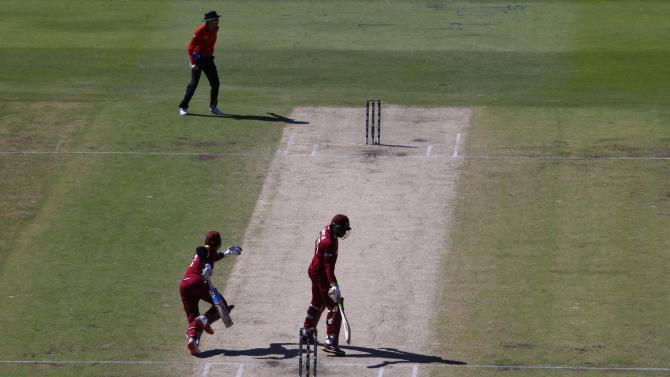 West Indies batsmen Marlon Samuels and his team mate Chris Gayle  are caught at the same end just before Samuels was run out at the vacant crease by India during their Cricket World Cup match in Perth