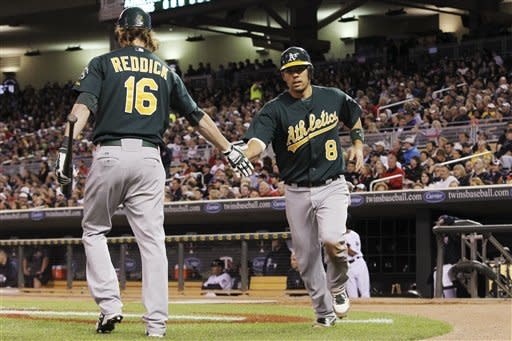 Willingham's 3-run HR in 9th lifts Twins over A's