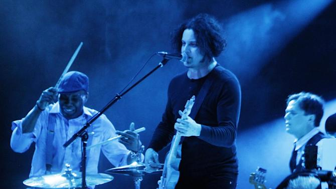 FILE - In this Aug. 5, 2012 file photo, Jack White, center, performs at Lollapalooza in Chicago's Grant Park. At the Austin City Limits Music Festival, about a third of the nearly 130 bands on a lineup that includes the Red Hot Chili Peppers, the Black Keys and Jack White will have their sets broadcast on YouTube. That's a record for the three-day festival that starts Friday, Oct. 12, 2012.  (Photo by Sitthixay Ditthavong/Invision/AP, File)