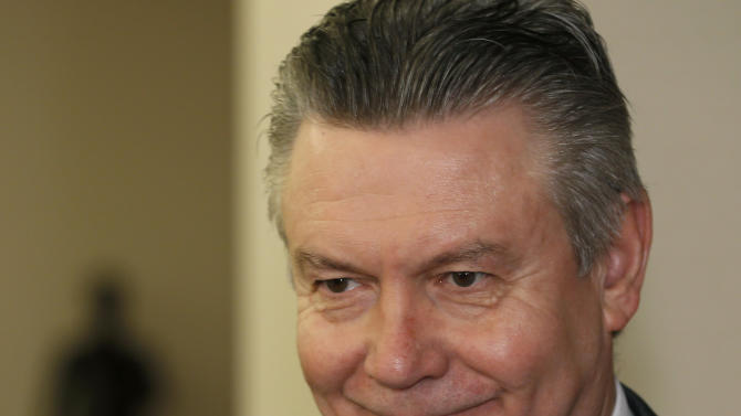 European Trade Commissioner Karel De Gucht smiles before meeting with Japanese Foreign Minister Fumio Kishida at Foreign Ministry in Tokyo, Monday, March 25, 2013. Japanese Prime Minister Shinzo Abe will discuss a possible free trade pact with the European Union even as a summit in Tokyo to launch the negotiations is postponed because of the financial crisis in Cyprus. De Gucht is in Tokyo and meeting with Japanese government and business officials as scheduled. (AP Photo/Shizuo Kambayashi)