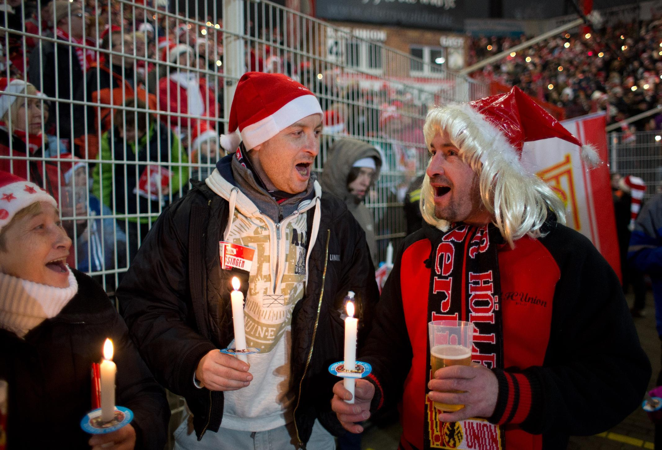 Berlin club swaps floodlit football for candle-lit carols