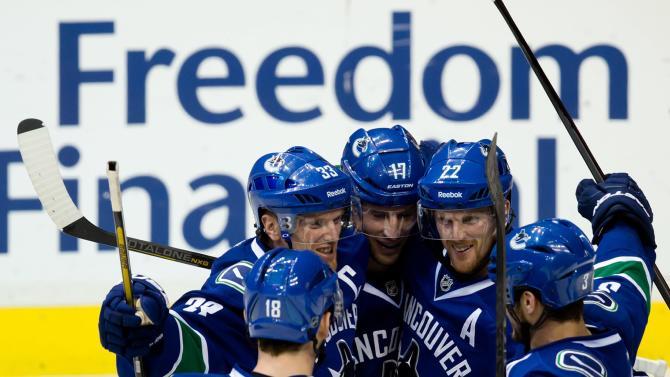 Sedin brothers lead Canucks past Blue Jackets, 6-2