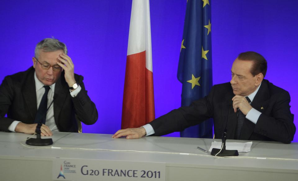 Italian Prime Minister Silvio Berlusconi, right, and Italian Finance Minister Giulio Tremonti react during his press conference at the G20 summit in Cannes, Friday, Nov.4, 2011. (AP Photo/Michel Euler)