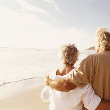 Senior-couple-standing-on-a-beach_web