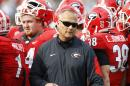 Georgia head coach walks out of a huddle during a timeout in the second half of an NCAA college football game against Georgia Tech on Saturday, Nov. 28, 2015, in Atlanta, Ga. Georgia won 13-7. (AP Photo/Brett Davis)