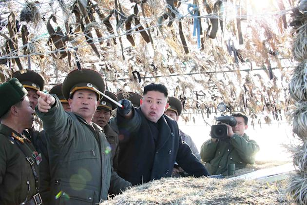 In this March 11, 2013 photo released by the Korean Central News Agency (KCNA) and distributed March 12, 2013 by the Korea News Service, North Korean leader Kim Jong Un, third left, looks at South's w
