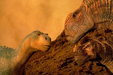 Aladar confronts the herd's leader, Kron (right), and his lieutenant, Bruton, as they push the herd relentlessly to their nesting ground in Disney's Dinosaur