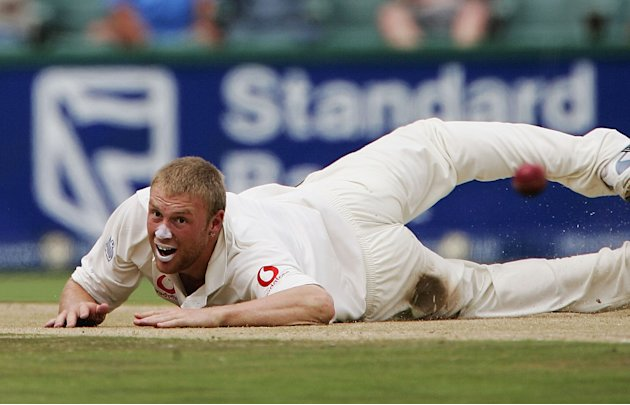 JOHANNESBURG - SOUTH AFRICA, JANUARY 16:  Andrew Flintoff of England attempts to field of his own bowling during the fourth day of the fourth test match between South Africa and England at the Wandere