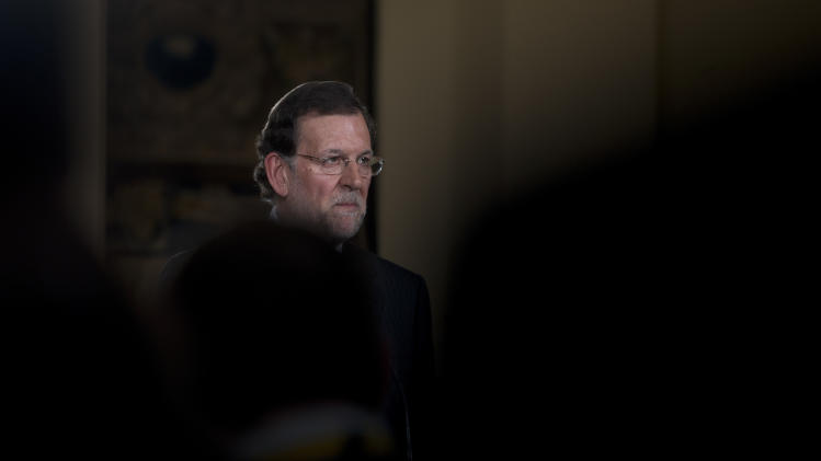 "Spain's Prime Minister Mariano Rajoy pauses during a news conference at the Moncloa Palace in Madrid, Friday Dec. 28, 2012. In his end of year assessment, Mariano Rajoy said Friday the crisis had been worse than he had anticipated and that the first half of 2013 will be ""very hard,"" but that the economy should begin to recover in the second semester. Rajoy says the country's economy will be in recession for some time and faces a tough year ahead as it grapples with a deep financial crisis and 25 percent unemployment. (AP Photo/Paul White)"