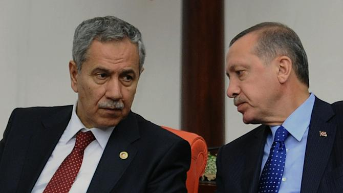 In this Monday, Oct. 1, 2012 photo, Prime Minister Recep Tayyip Erdogan, right, and his deputy Bulent Arinc are seen at Turkey's parliament in Ankara, Turkey. Turkey fired on Syrian targets for a second day Thursday, Oct. 4, 2012, but said it has no intention of declaring war, despite tensions after deadly shelling from Syria killed five civilians in a Turkish border town. Turkey's Parliament, meanwhile, began an emergency session to discuss a bill authorizing the military to launch cross border operations in Syria. If approved, the bill could more easily open the way to unilateral action by Turkey's armed forces inside Syria, without the involvement of its Western and Arab allies. (AP Photo)