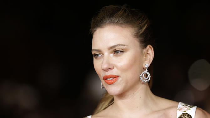 FILE - In this Nov. 10, 2013 file photo, actress Scarlett Johansson arrives for the screening of the film 'Her' at the 8th edition of the Rome International Film Festival in Rome. Oxfam International said Thursday, Jan. 30, 2014, that American actress Scarlett Johansson's support of an Israeli company operating in a West Bank settlement was incompatible with her role as an Oxfam Global Ambassador. Johansson parts ways with Oxfam because of a dispute over her work for SodaStream, an Israeli company operating in a West Bank settlement that is featuring the Hollywood star in an ad during the Super Bowl. (AP Photo/Alessandra Tarantino, File)