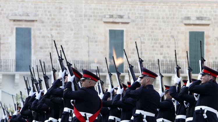 Armed Forces of Malta soldiers fire a 'feu de joie' during a military parade to mark Malta's Republic Day in Valletta