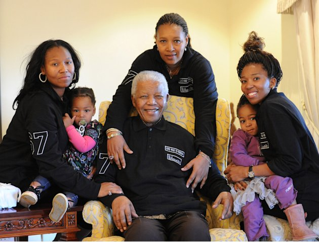 In this hand out photograph supplied by Peter Morey Photographic for the Mandela family, showing former South Africa president Nelson Mandela, center, with family members left to right Zaziwe Manaway,