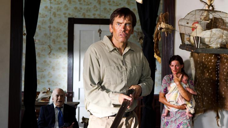 "This undated publicity film image from Lionsgate shows John Dugan, left, as Grandpa Sawyer, and Bill Moseley, center, as Drayton Sawyer, in a scene from ""Texas Chainsaw 3-D,"" releasing in theaters on Friday, January 4, 2013.  (AP Photo/Lionsgate, Justin Lubin)"
