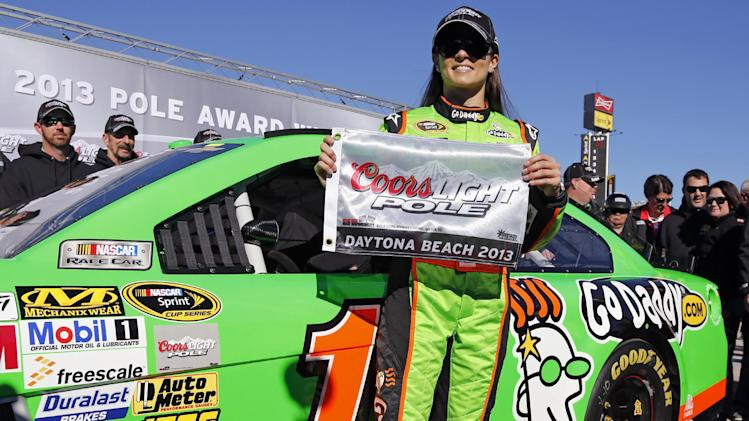 Danica Patrick displays the flag after winning the pole during qualifying for the NASCAR Daytona 500 Sprint Cup Series auto race at Daytona International Speedway, Sunday, Feb. 17, 2013, in Daytona Beach, Fla. Patrick won the pole, becoming the first woman to secure the top spot for any Sprint Cup race. (AP Photo/Terry Renna)