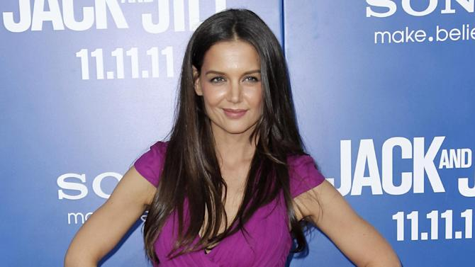 """FILE - This Nov. 11, 2011 file photo shows actress Katie Holmes at the premiere of """"Jack and Jill"""" in Los Angeles.  Holmes will star in Theresa Rebeck's new play, """"Dead Accounts,"""" a five character comedy, directed by three-time Tony Award winner Jack O'Brien.  The play will open on Broadway this fall at the Music Box Theatre in New York. (AP Photo/Matt Sayles, file)"""