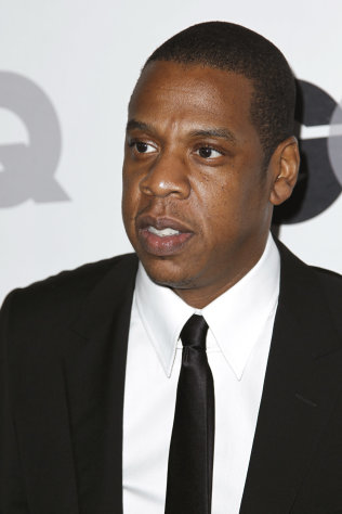 FILE - In this Nov. 17, 2011 file photo, Jay-Z arrives at the 16th annual GQ &quot;Men of the Year&quot; party in Los Angeles. Michael Eric Dyson parses Jay-Zs lyrics as if analyzing fine literature. The rappers riffs on luxury cars and tailored clothes and boasts of being the Mike Jordan of recording may make for catchy rhymes, but to Dyson, they also reflect incisive social commentary. Dyson, a professor, author, radio host and television personality, has offered at Georgetown University this semester a popular _ if unusual _ class dedicated to Jay-Z and his career. (AP Photo/Matt Sayles, File)